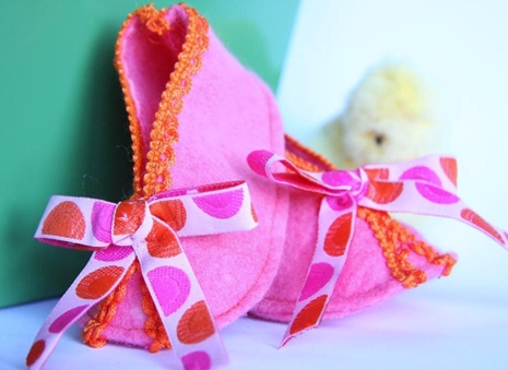 ribbons on baby booties, red-thread-designs