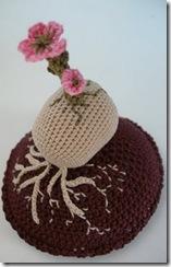 crochet cherry blossom tree on rock