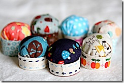 tiny pin cushions made with recycled bottle caps