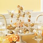 new years eve table centerpiece with bubbly champagne flutes
