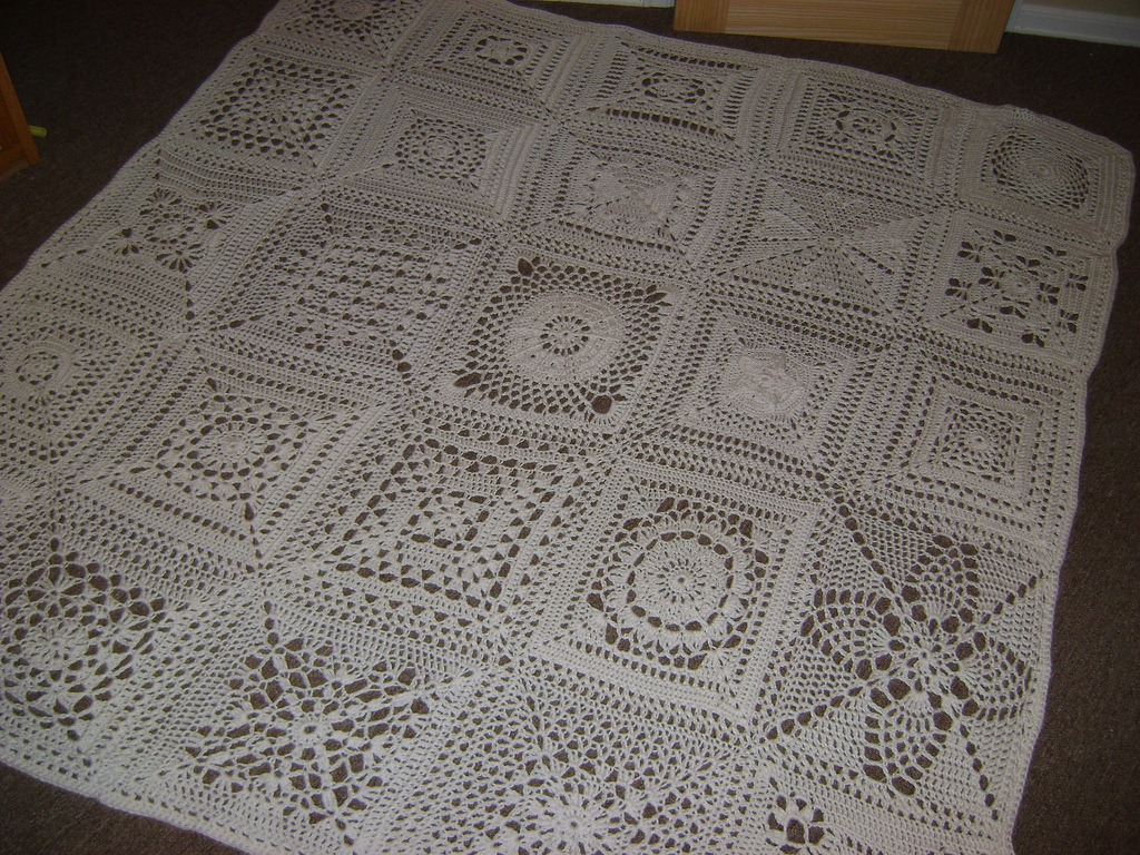 Crochet Patterns Squares : Snuggle up with this lovely throw blanket on your sofa, or use it as ...