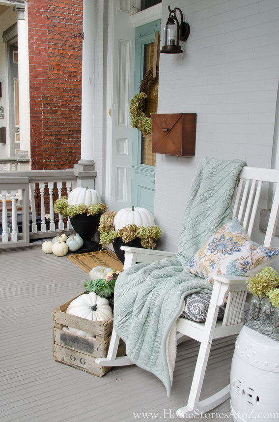 fall porch  ideas -- dress it up with blankets and pumpkins