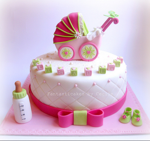 Baby shower cakes with pram, blocks bottle and bow