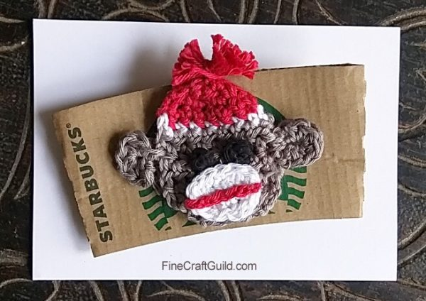 crochet pattern sock monkey brooch