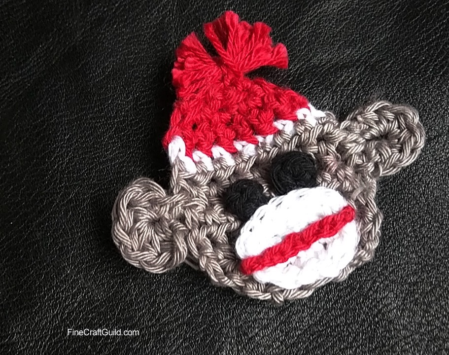 crochet brooch sock monkey pattern