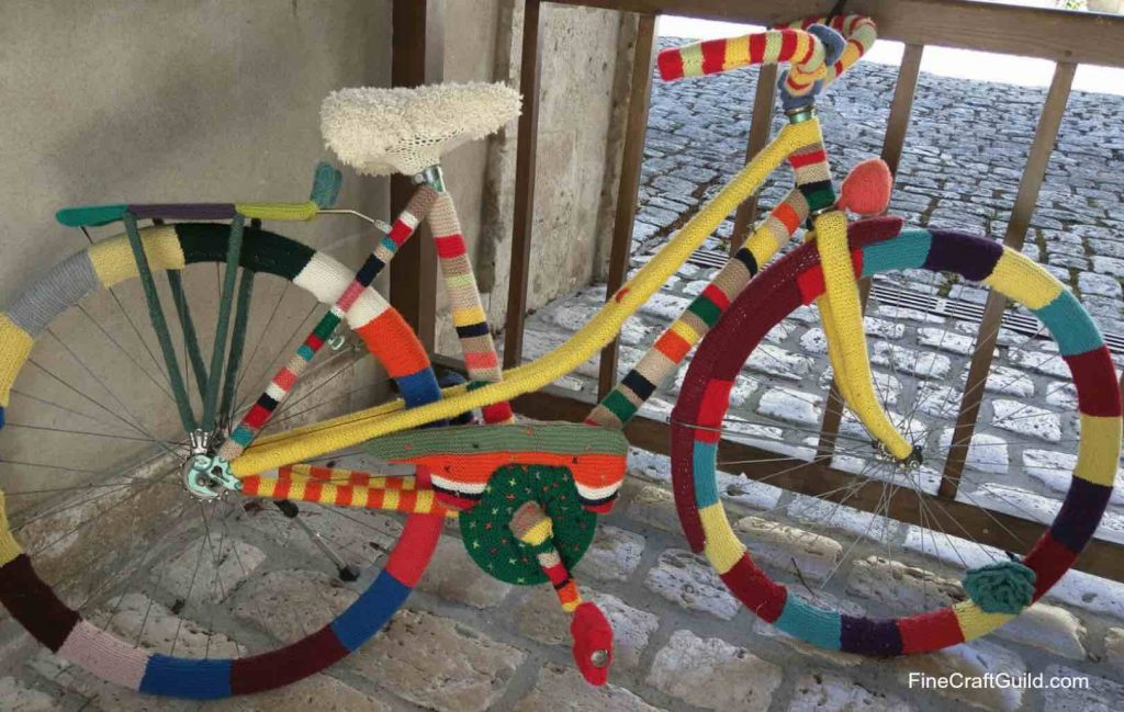 Iloveyarnday-yarnbomb-chateau beaugency - FineCraftGuild.com
